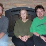 Me, Mom, and Kurt by the fireplace in our cabin.